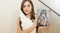 sasha grey holding a book